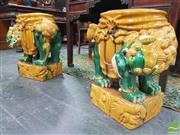 Sale 8444 - Lot 1022 - Pair of Chinese Sancai Glazed Ceramic Temple Dogs, with averted heads, standing on rocky mounds