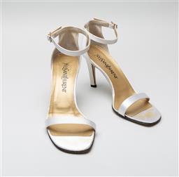 Sale 9092F - Lot 83 - A PAIR OF YVES SAINT LAURENT; Ivory satin and leather mary jane stilettos, size 6.5M (with box)
