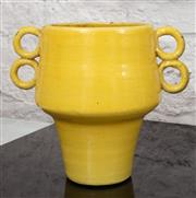 Sale 9066H - Lot 186 - A yellow painted terracotta twin handled vessel in the mid century style, Height 24cm