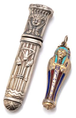 Sale 9149 - Lot 366 - A VINTAGE ANCIENT EGYPTIAN THEMED ENAMELLED SILVER PENDANT AND ETUI; enamelled silver gilt sarcophagus pendant opening to reveal ena...