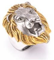 Sale 8982 - Lot 306 - A LION HEAD RING; in gold plated metal, size R, 36 x 25mm, wt. 25.72g.