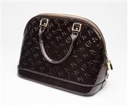 Sale 8550F - Lot 3 - A Louis Vuitton Alma PM monogram vernis leather in amarante, as new with dust bag, width 32cm, SP0012