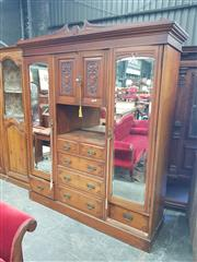 Sale 8868 - Lot 1159 - Late Victorian Walnut Wardrobe, with two carved panel doors, open shelf and five drawers, flanked by long mirror doors
