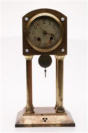Sale 9049 - Lot 21 - An Early 20th Century Brass bound Clock (UNTESTED, Some wear) H: 37cm