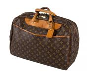Sale 8522A - Lot 20 - A vintage French louis Vuitton travel / overnight bag, some wear to handles, 50 x 35 cm.