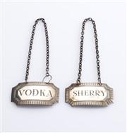 Sale 8528A - Lot 46 - Two sterling silver decanter labels, marked Birmingham, Hardy Bros & Co, Vodka and Sherry, each L 4.5cm