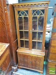 Sale 8428 - Lot 1071 - Georgian Style Yewwood Veneered Bookcase, by Reprodux, with two astragal doors, slide and two panel doors