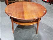 Sale 8705 - Lot 1048 - Round Teak Coffee Table with Rattan Shelf Below