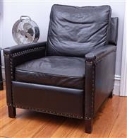 Sale 8891H - Lot 29 - An ebony leather studded full reclining armchair (goes from upright to completely horizontal). Height of back 84cm, Width 78cm x Dep...