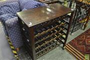 Sale 8341 - Lot 1041 - Timber Wine Rack on Castors