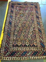 Sale 8634 - Lot 1012 - Antique Probably Caucasian (Kuba?) Wool Carpet, with interlocking field of botehs on a black ground, within colourful striped border...