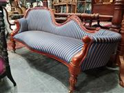 Sale 8925 - Lot 1027 - A brightly striped upholstered carved timber chaise in blue