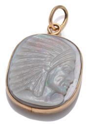 Sale 9074 - Lot 344 - A 14CT GOLD OPAL PENDANT; 25 x 23mm cushion form pendant set with carved solid opal plaque featuring an American Indian chief in pro...