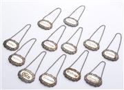 Sale 8528A - Lot 53 - Twelve Sheffield plate fancy engraved decanter labels, each L 5.5cm