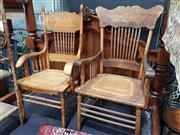 Sale 8925 - Lot 1012 - Two similar spindle back and cane seat oak armchairs