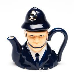Sale 9246 - Lot 68 - A boxed miniature novelty policeman teapot (H:9cm)