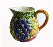 Sale 8828B - Lot 12 - An early C20th French Sarreguemines majolica fruits decorated jug, some wear/crack to top rim. Height 16 cm