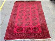 Sale 8962 - Lot 1090 - Afghan Filpa in Red & Black Tones (292 x 200cm)