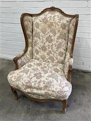 Sale 9068 - Lot 1043 - Louis XV Style Probably Walnut Wingback Armchair, fully upholstered in a cream fabric with floral arabesques & on cabriole legs (h:1...