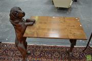 Sale 8460 - Lot 1003 - Late 19th / Early 20th Century Alpine Region Pine Novelty Occasional Table, one support modelled as a life-like retriever, the other...