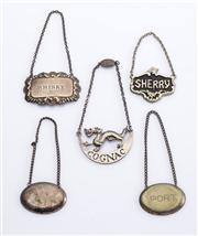 Sale 8528A - Lot 59 - Five various vintage silver plated decanter labels, largest L 5.5cm
