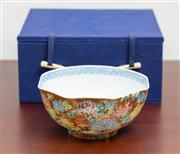 Sale 8774A - Lot 13 - A porcelain Japanese bowl, with Satsuma decoration on the outside and blue and white on the inside, diameter 13cm in fitted case