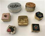 Sale 8436A - Lot 13 - A group of seven floral pill boxes mainly in gold tone, some with enamelled lids.