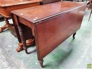 Sale 8598 - Lot 1042 - Early Victorian Mahogany Drop-Leaf Dining Table, on turned legs with gate leg action (H: 69 L: 132 W: 105cm)