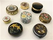 Sale 8436A - Lot 14 - A group of eight floral themed circular pill boxes including alabaster, enamel and gold tone.