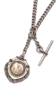 Sale 9074 - Lot 400 - A VINTAGE SILVER ALBERT CHAIN WITH FOB; curb links with swivel and t-bar attached with a shield shape fob centring a 2 tone 9ct gold...
