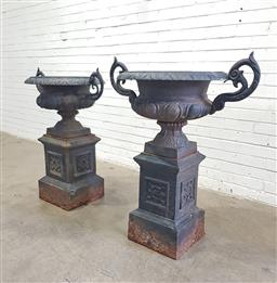 Sale 9126 - Lot 1003 - Pair of Large Cast Iron Garden Urns, of squat form with two scroll handles, the lower body with egg-and-dart moulding, the square fe...