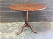 Sale 8976 - Lot 1010 - George III Mahogany Wine Table, the circular top on gun barrel pedestal (H:71 x D:79cm)