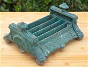 Sale 9066H - Lot 169 - A cast iron green painted boot scrape. W 28cm.