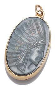 Sale 9074 - Lot 342 - A VINTAGE GOLD OPAL PENDANT; 28 x 18mm oval pendant set with a carved solid opal plaque featuring an American Indian chief in profil...