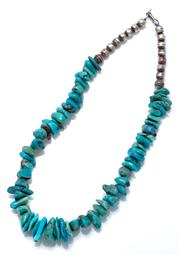 Sale 9083 - Lot 327 - A NATIVE AMERICAN INDIAN GRADUATED TURQUOISE BEAD NECKLACE; 13 - 20mm tumbled beads to silver bead ends and hook clasp, length 39cm.