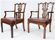 Sale 9080J - Lot 11 - An oversized pair of antique superbly carved mahogany elbow chairs C: 1900s. These Chippendale 18th century style chairs with a trip...
