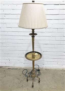 Sale 9126 - Lot 1079 - Short Brass Candle Form Floor Lamp, with drip-tray style shelf & on three outswept feet, having a cream pleated shade (h:136cm)
