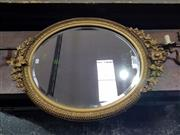 Sale 8714 - Lot 1030 - Victorian Gilt Gesso Oval Mirror, with moulded border & surmounted by vines