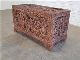 Sale 9154 - Lot 1036 - Heavily carved timber camphorwood oriental themed trunk (h67 x w122 x d57cm)