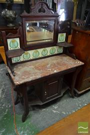 Sale 8500 - Lot 1054 - Edwardian Oak Wash Stand With Tiled Back and Adjustable Mirror, Marble Top and Cupboard Below