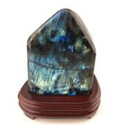 Sale 8758 - Lot 26 - Labradorite in free form on wood base, Madagascar