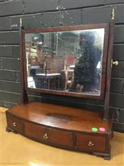 Sale 8976 - Lot 1048 - George III Mahogany Tiolet Mirror, with reeded supports & brass finials, the bow front with three drawers & ogee bracket feet (H:64...