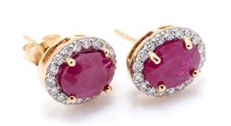 Sale 9246J - Lot 363 - A PAIR OF 9CT GOLD  RUBY AND DIAMOND CLUSTER STUD EARRINGS; each centring an oval cut treated ruby (1 surface reaching fracture) to...