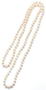Sale 9054 - Lot 392 - AN OPERA LENGTH CULTURED PEARL NECKLACE; 5.2 - 5.6mm round pearls of good colour and lustre, length 80cm.