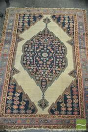 Sale 8390 - Lot 1490 - Antique Mazlagan Wool Carpet, with cream medallion on a blue floral field (some losses, 177 x 128cm)