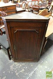 Sale 8500 - Lot 1052 - Georgian Oak Wall Hanging Corner Cabinet with Panel Door Enclosing Shaped Shelves