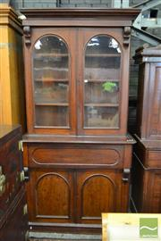 Sale 8520 - Lot 1022 - Late 19th Century Cedar Bookcase with two Arched Glass Panel Doors with Corbels, a long drawer & two further doors (Key in Office)