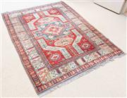 Sale 8550H - Lot 41 - An antique Kazak rug with typical geometric pattern and red on ground, L 140 x W 105cm