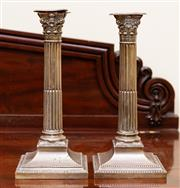 Sale 8882H - Lot 40 - A pair of late Victorian sterling silver corinthian column candlesticks with detachable nozzles, London, maker TB, Height 26cm