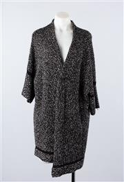 Sale 8760F - Lot 50 - A never-worn Basler wool-blend black and white cardigan, size 44